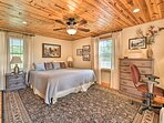 The master bedroom offers a king bed.