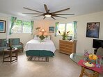 Gorgeous 99' fan and mood lighting behind the bed make for a romantic, tropical setting