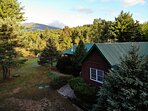 Esther Mountain Chalet nestled in the woods with fantastic views of the mountains.