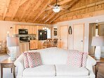 Open beamed ceilings and ceiling fan for comfort.