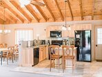 The kitchen has a full complement of tools and appliances.  The dining area has plenty of seating for all of your...