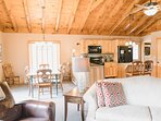 Comfortable seating in the living area, spacious dining area, and gourmet kitchen make Esther Mountain Chalet a perfect...