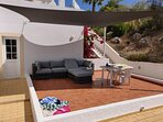 Poolside sofas and sail shade