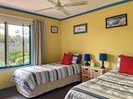 3rd bedroom - single beds, storage and garden view