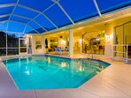 Vacanza Rentals - Villa Sunshine pool area by night