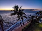 View off lanai looking down at beach at sunset. Also looking at the Island of Molokai.