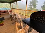 Backyard balcony with hot tub/picnic table/gas grill/oak rocking chairs