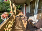 Spacious front porch with adirondack chairs