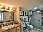 Guest bath with stand up shower and sitting shelf