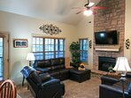2020 photo of Great room with new leather furniture and gas fireplace
