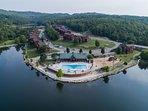 aerial view of fox hollow with pool, volleyball, playground, pavilion and catch release fishing