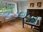 Open Plan Living/Dining area with 2 seater sofa and dining table (recently replaced)  with a view