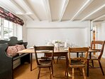 The dining table comfortably seats six guests