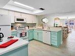 Fully stocked bright kitchen.