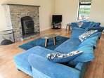 Muckno Lodge Spacious Living Room with Cosy Fireplace & Wood Burning Stove