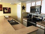 Beautifully appointment kitchen with all your needs to enjoy your stay.