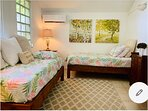 Room 3. Two twin beds and a daybed inside.