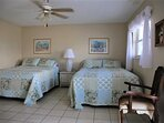 Master bedroom has 2 queen beds, brand new wall mounted TV and private balcony