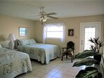 Master bedroom received a refresh too - balcony overlooks Gulf Blvd and the bay
