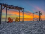 Watch a beautiful sunset with your toes in the sand!