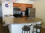Fully equipped kitchen with fridge, microwave, stove, oven and dishwasher.