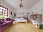 Upstairs en-suite bedroom with queen bed