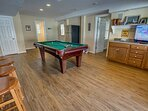 Ground-Level Rec Room with Pool Table and Access to Pool Deck