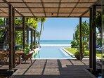 Noku Beach House - View to pool and the beach