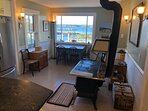DR with 2nd wood stove and view of the ocean as you eat. Table has extension to seat up to 7.