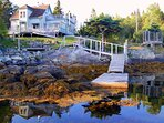 We sit on a pretty, secluded cove overlooking a bay.  Accessible by car. Dock may not be available.