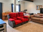 The lower level features an air hockey table and comfortable accommodations.