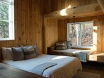 Located upstairs this bedroom has a queen bed + a day bed and is overlooking the living room