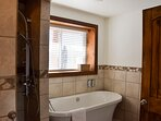 Bathroom at ground level with shower and bathtub