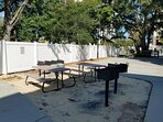 charcoal grills and picnic tables for all guests to use