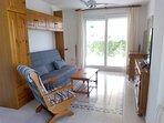 Salón: Zona de estar con sofá-cama