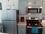 Brand new General Electric stainless steel fridge, stove and microwave.