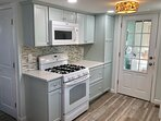 Custom soft-close cabinets and over-the-range microwave. Gas stove!
