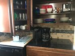 Keurig and coffee maker available. View of plates, bowls, and toaster. We provide coffee filters.