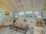 Living room windows overlook the 11th fairway of the Ocean Winds golf course.