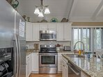 The updated kitchen has stainless steel appliances, a Bosch dishwasher, granite counters and every kitchen utensil you...
