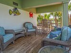 Relax on the shady deck under the home while enjoying the lagoon view.