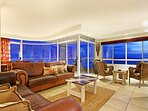 Large living area with wrap-around windows for stunning views.