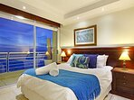 Master bedroom with spectacular ocean views and balcony.