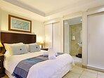 Second bedroom with queen size bed, large cupboards and en-suite bathroom.