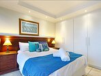 Master bedroom with queen size bed and ample cupboard space.