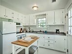 The fully equipped kitchen features modern appliances and a butcher block island