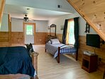 Upstairs bedroom with queen size bed and twin bed, looking towards private deck.