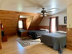 Open loft area with two Queen beds and one twin bed