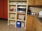 Coffee pot. Microwave. Shelf storage