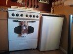 Four burner stove and mini fridge